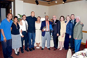 Pictured from left to right: Simpson family members with MIA Volunteer Ambassador of the Year winner Ray Simpson; MDAD Aviation Director José Abreu; Assistant County Manager Ysela Llort; MDAD Terminal Operations and Customer Service Division Director Dickie Davis; MDAD Deputy Director of Operations Ken Pyatt; and GMCVB President and CEO Bill Talbert.